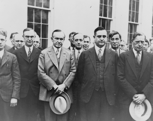 President Coolidge with reporters, 1929