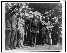 Newspapermen cheering CC after first conference with him 1923