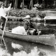 Beaver Dick Canoe President Calvin Coolidge fishing at Cedar Island Lodge, rustic lodge of Henry C. Pierce, 35 miles from Superior, Wisconsin, on the Brule River. Guide John LaRock