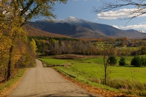 Fall foliage in Cambridge, Vermont with snow capped Mt. Mansfield.