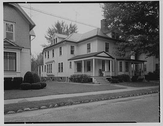 Home at 21 Massasoit Street, Northampton, with Coolidge's favorite place - the front porch - and rocking chair in plain view.