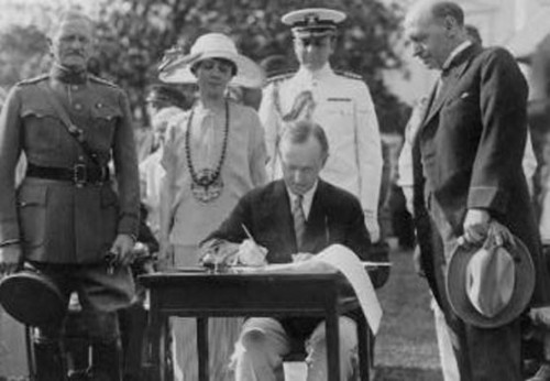 The President signing the Johnson-Reed Act, on the south lawn of the White House, May 26, 1924.