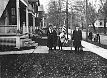 The Coolidge family, on Massasoit Street in Northampton, raising the flag, Thanksgiving Day, 1919