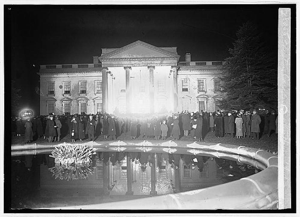 The singing of carols at the North Portico of the White House, a main feature of the Coolidges years, is pictured as it looked that first Christmas of 1923.