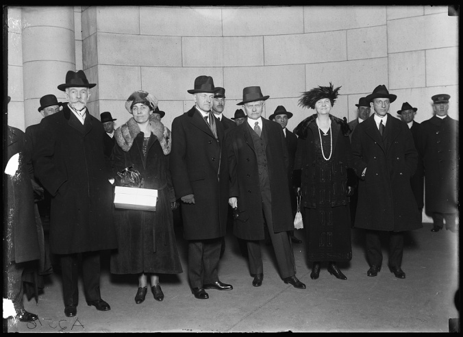 Senator Henry Cabot Lodge, a long-time political antagonist of Coolidge's advancement, stands beside Mrs. Coolidge and the Vice President, who stands beside outgoing Vice President Thomas Marshall and Mrs. Marshall. While not evident in this picture, Mr. Marshall possessed a keen sense of humor, hitting it off with the new VP almost immediately. The Marshalls helped the Coolidges get situated in Washington and became firm friends with his successor and the lovely Mrs. Coolidge. Photo taken in 1921.