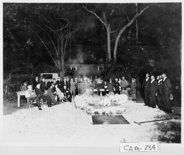 The Coolidges at Cabin Bluff enjoying an old-fashioned oyster roast around the fire. The President and Mrs. Coolidge are seated in the front row on the left (Grace is third from left, Calvin sits on the far right end).
