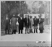 "President Coolidge at Cabin Bluff with the ""spiritual"" singers of Georgia Industrial College."