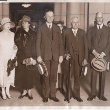 President Coolidge stands beside two of his greatest partners in policy: Secretary Frank B. Kellogg in foreign affairs and Secretary Andrew W. Mellon in domestic business, particularly tax policy.