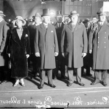 The Coolidges are standing with Oscar Bradfute, to the President's left, in a picture taken in Chicago before Coolidge's address.