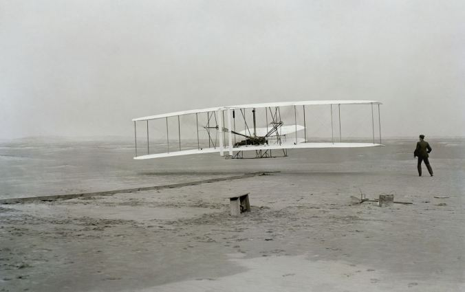 The first flight at Kitty Hawk by the Wright brothers, December 1903.