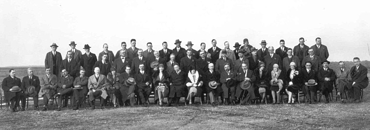 Delegates pose for a group photograph on December 15th, at Langley Memorial Aeronautical Laboratory. Orville Wright is seated in the front row to the right of the woman with the white fur collar.