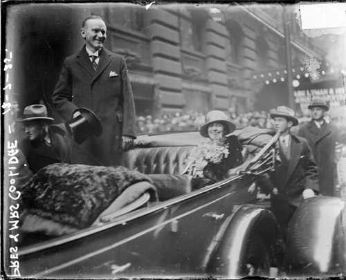 President and Mrs. Coolidge outside the La Salle Hotel during their visit to Chicago, 1925.
