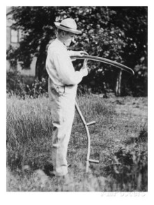 Coolidge sharpening a scythe in order to cut his grass.
