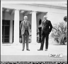"Calvin Coolidge and his friend and host, entrepreneur Howard E. Coffin, as they walk the terrace of ""The Big House"" built by Thomas Spalding, 1810, Sapelo Island."
