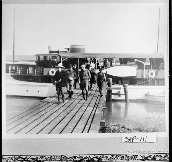 The Presidential hunting party disembarks from the Zapala, which would consider Georgia its home base for fourteen years, 1927-1941.