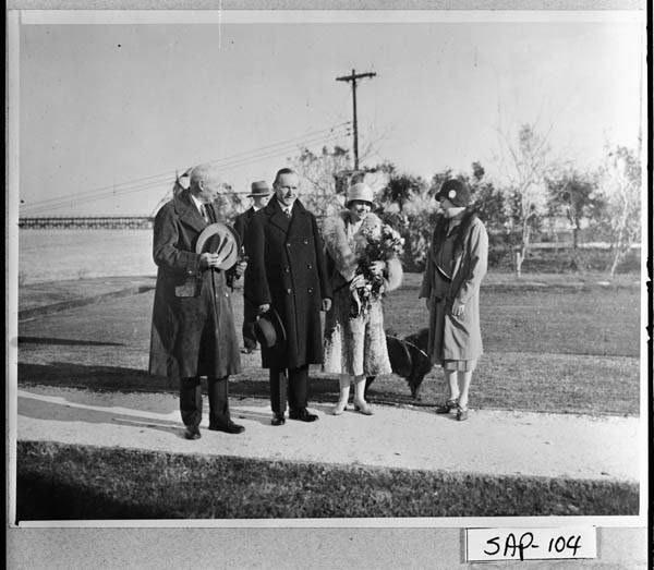 President and Mrs. Coolidge welcomed by their hosts, Mr. and Mrs. Howard E. Coffin, at the Sea Island Yacht Club.