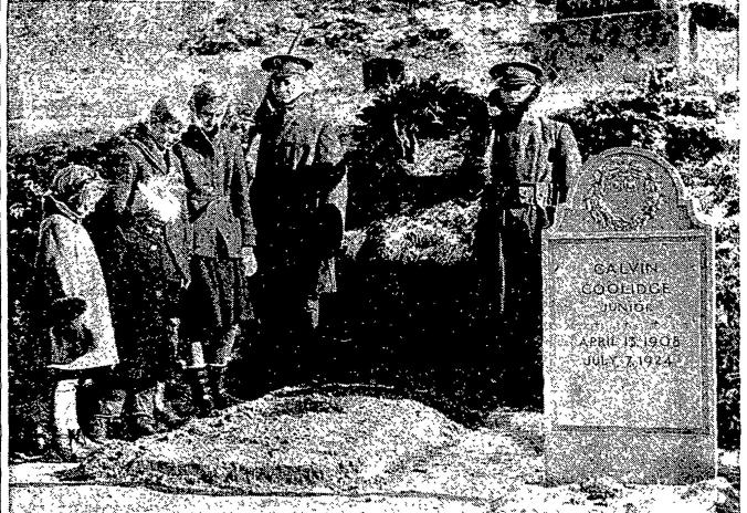 Children standing respectfully beside the grave of Calvin Coolidge, Plymouth Notch. Notice there is not yet a stone in place.
