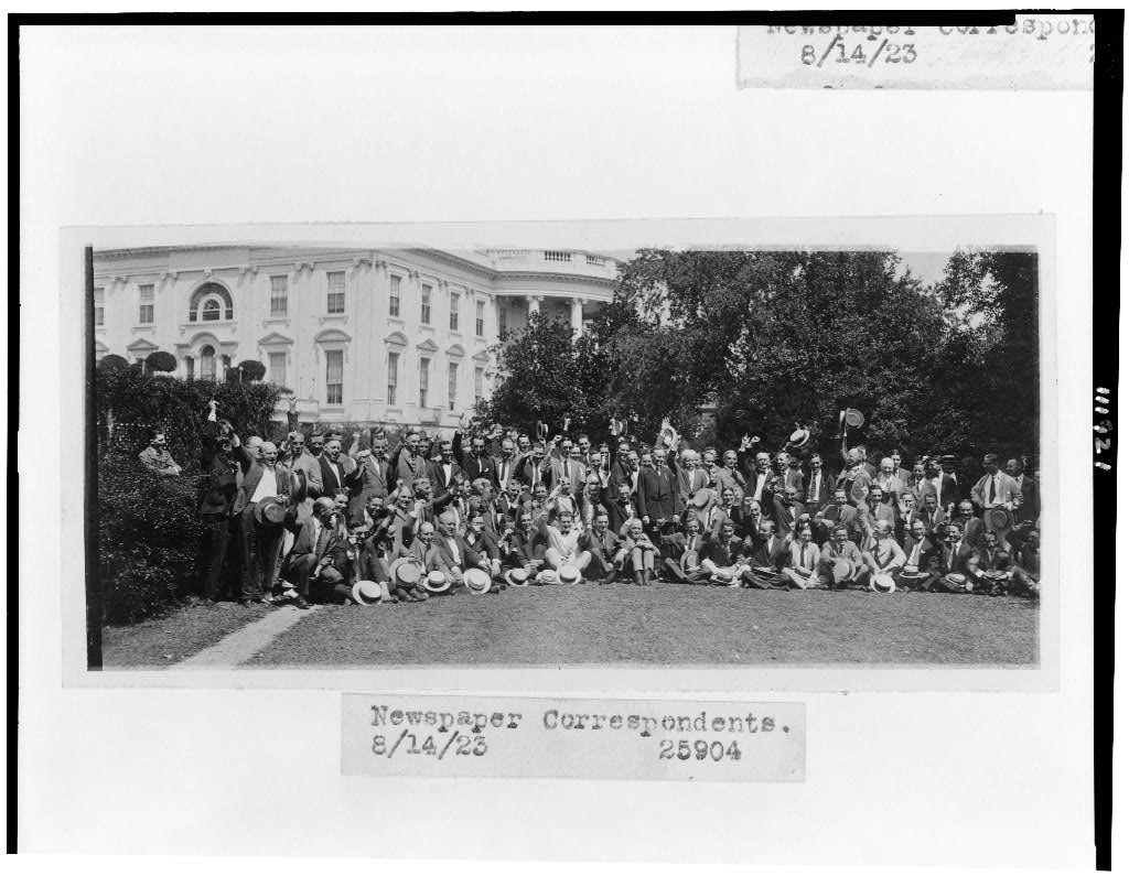 "President Coolidge poses with the Washington correspondents corps on the lawn of the White House, August 14, 1923. The press, not without its biases and healthy curiosity even then, remained fair to Coolidge throughout his five years and seven months in office. They had their hostile critics, like correspondent Frank Kent and others, but none walked in the unquestioned conformity they largely do today. Coolidge could honestly assess their coverage in these terms: ""You have been, I think, quite successful in interpreting the administration to the country. I have known that I wasn't much of a success in undertaking newspaper work, so I have left the work of reporting the affairs of my administration to the experts of the press. Perhaps that is the reason that the reports have been more successful than they would have been if I had undertaken myself to direct them"" (March 1, 1929, The Talkative President, p. 34). Coolidge practiced what he preaches, letting the press do their job, free of forceful directives on what to report from the White House."