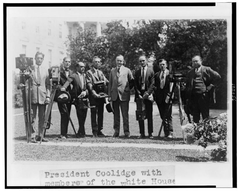 President Coolidge with members of the White House Photographers Association, 1923.