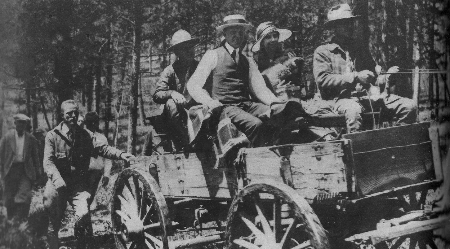 President and First Lady back aboard the lumber wagon after it got stuck along the trail en route to the Game Lodge. Calvin, it was remembered, got out and put his shoulder to the wagon, helping push it out of the ruts and back in motion. How many Presidents would have done that? Notice in the second picture he has removed his suit jacket, leaving it clean for their arrival.