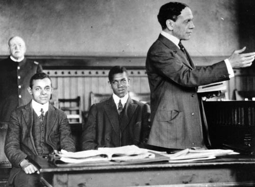 William H. Lewis, standing, argues a case before a Massachusetts court, 1910s. He had graduated Amherst three years before Coolidge, who wrote his father at the time about Lewis' skill as a football player, saving the college team on more than one occasion. Lewis, a Republican, failed to see why Coolidge would not verbally condemn the Klan in 1924. Lewis failed to appreciate Coolidge's subtle yet more effective approach to the problem.