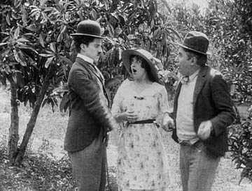 Chaplin and Sennett seen together in The Fatal Mallet, 1914. Mabel Normand stands between them.
