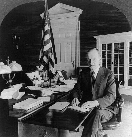 coolidge working at desk