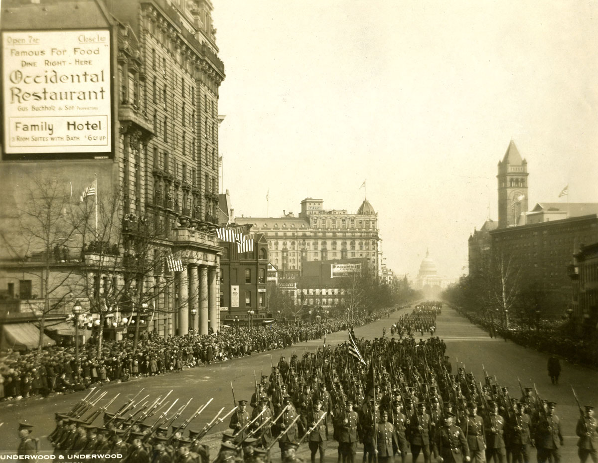 View down Pennsylvania Avenue with the Capitol in the background, as a wide variety of America's servicemen march in honor of President Coolidge's inauguration.