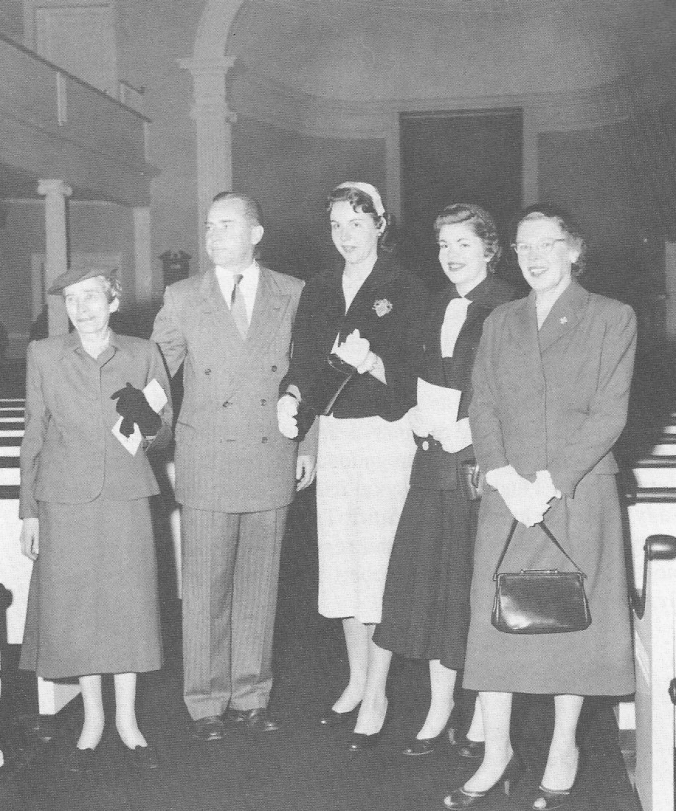 "The Coolidge family at the dedication of the Calvin Coolidge Memorial Room in Forbes Library, September 1956. This would prove to be Grace's final public appearance. Her ""Precious Four,"" as she called children John and Florence with granddaughters Cynthia and Lydia, are featured in Gloria May Stoddard's fine book, Grace and Cal: A Vermont Love Story, p.153). This photograph is found in the holdings of Forbes Library."