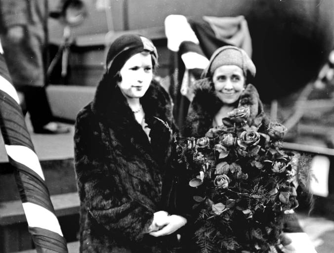 Both Mrs. Coolidge and Mrs. Coolidge stand for their picture at the dock in Newport News, Virginia.