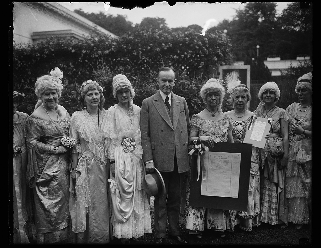 """Holding the """"Nation's Birthday Book"""" these Daughters visit President Coolidge in preparation for the Sesquicentennial that year, 1926."""