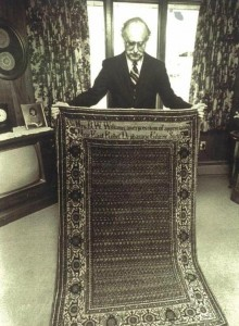 Dr. Deranian holding the sister rug to the one presented to President Coolidge, 1925.