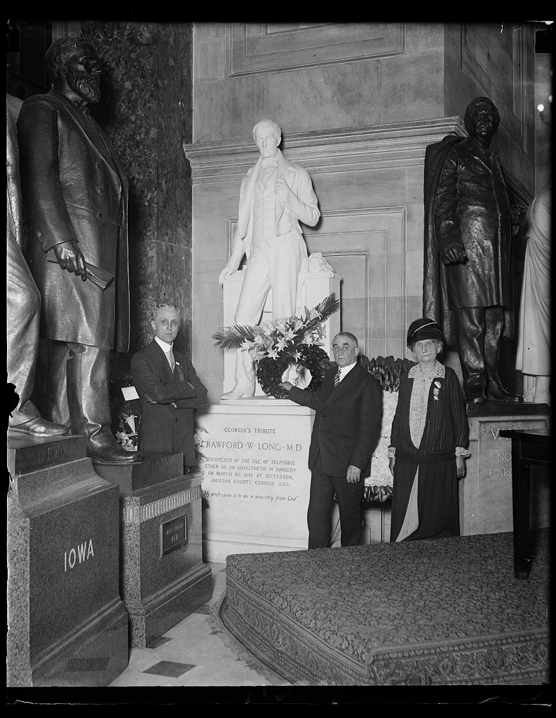 Gathered to honor the memory of the American who discovered the aesthetic properties in surgery of sulphuric ether, Dr. Thomas A. Grooner, Dr. Charles H. Mayo and the daughter of Dr. Long, visit the statue of Crawford from Georgia, May 16, 1927.
