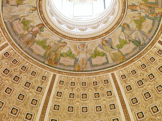 "Looking up at the Dome of the Library of Congress, featuring the ""Evolution of Civilizations"" mural"
