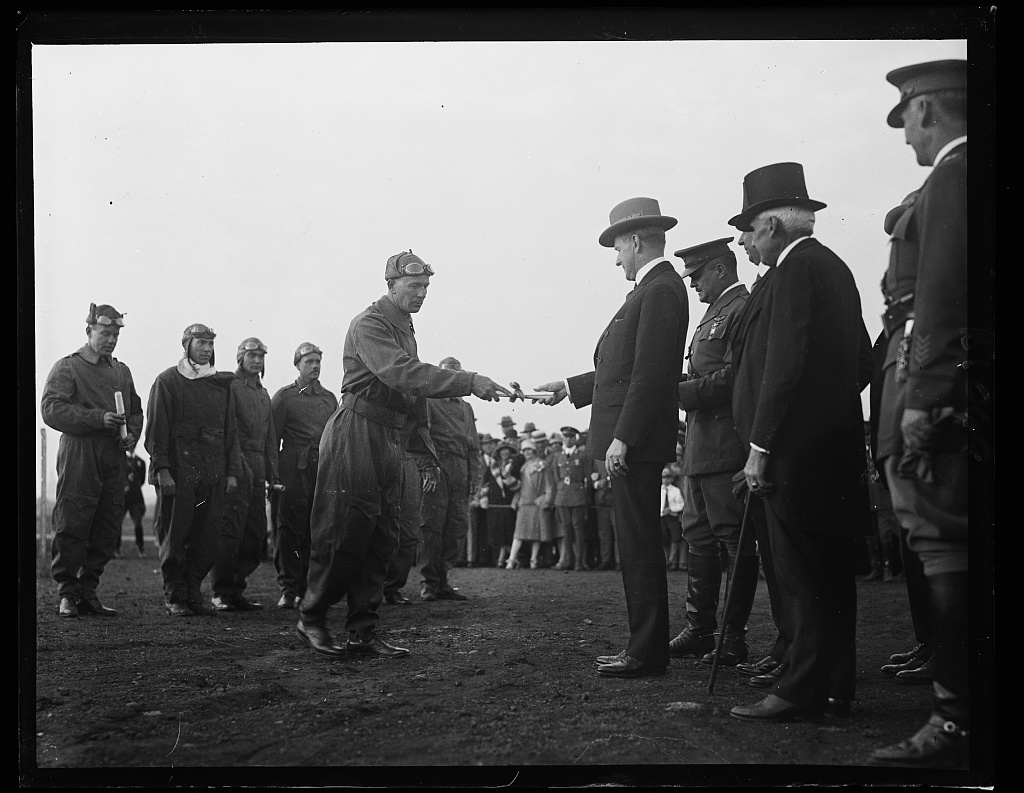 President Coolidge gave the Distinguished Flying Cross certificate for the first time just over a month before the Lindbergh ceremony. Here Major Herbert A. Dargue accepts one of the ten awards bestowed that day, May 2, 1927. Two would be given posthumously in recognition of Captain Clinton Woolsey and Lieutenant John Benton who tragically died from collision with another of the 5 ships to take part in the Pan-American Goodwill Flight, February 26, 1927.