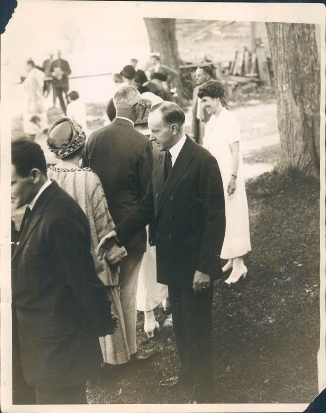 Calvin and Grace greeting Americans on the White House lawn