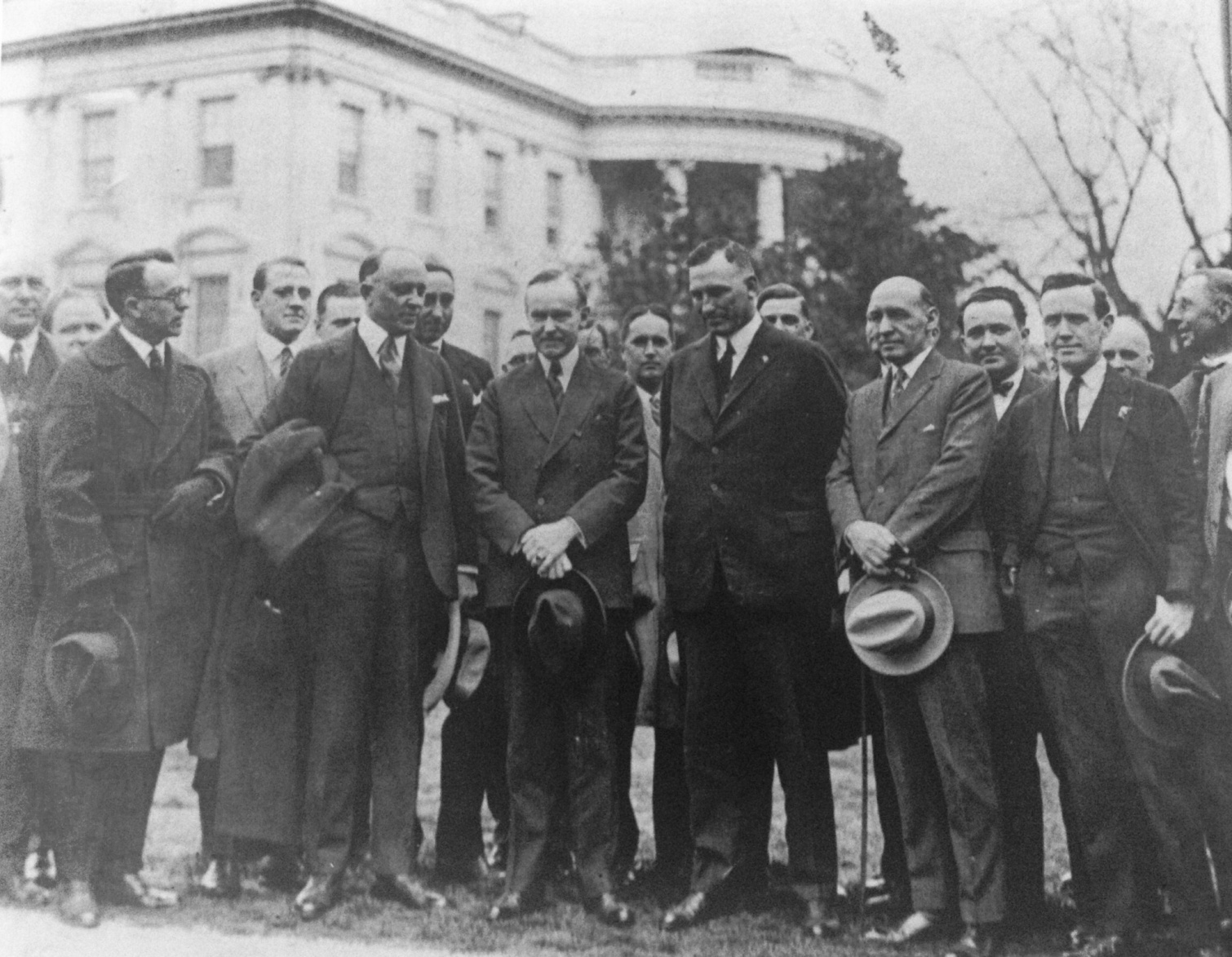 "President Coolidge surrounded by members of the American Legion, led by John Quinn, pressuring for the Veterans' Bonus Bill, what would become the World War Adjusted Compensation Act passed by Congress over the President's veto, May 1924. Coolidge firmly disagreed with direct compensation levied upon the rest of the people. As he declared, ""patriotism...bought and paid for is not patriotism."""