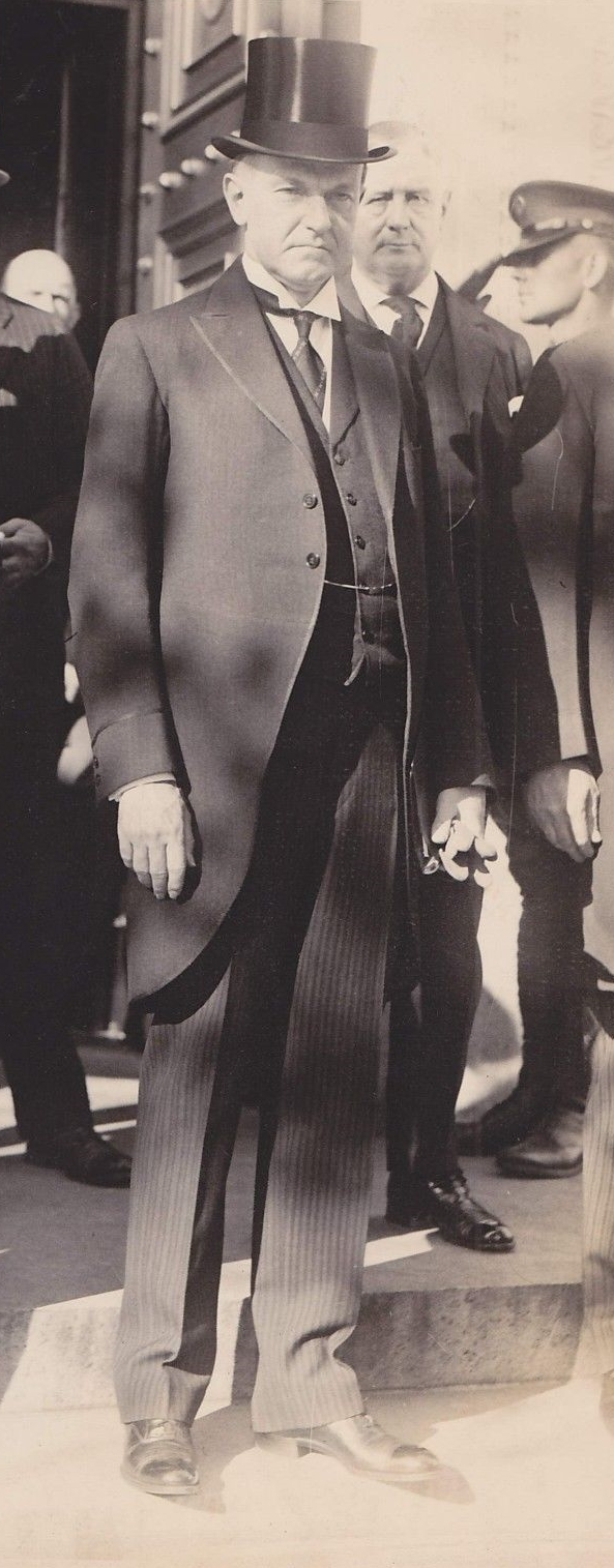 President Coolidge with Postmaster General New standing over his left shoulder.