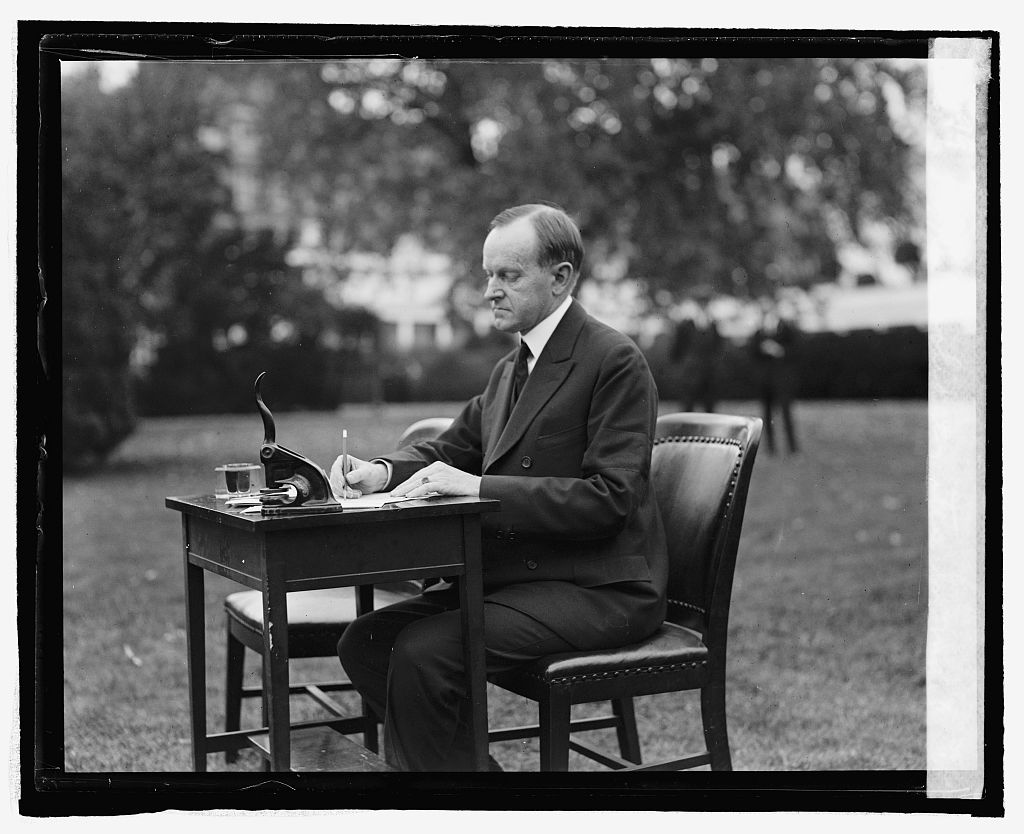 President Coolidge filling out his own absentee ballot to vote in his hometown elections, 1924.