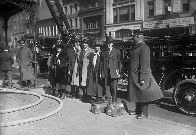 As the fire is put out, the Coolidges and some of their fellow guests watch from below. L to R: Miss J. Letley, A.H. Duerno, of Springfield Mass., O.H. Wigley of New York, Mrs. Coolidge and Vice President. Coolidge. Courtesy of Corbis Images.