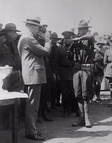 President Coolidge Saluting Soldier