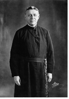 The Most Reverend Joseph N. Dinand, President of Holy Cross in the years leading up to the War, 1911-1918 and during most of Coolidge's administration, 1924-1927. It was President Dinand who largely built up the College's great library, which bears his name today.