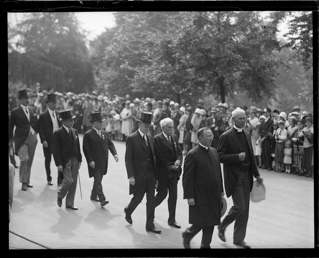 Former President Coolidge walking with fellow citizens in the parade celebrating the Tercentenary of Boston, July 1930.