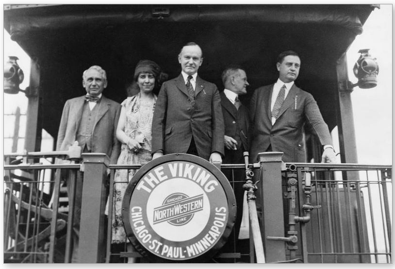 The President and party aboard a whistle stop tour through Minnesota, 1925.