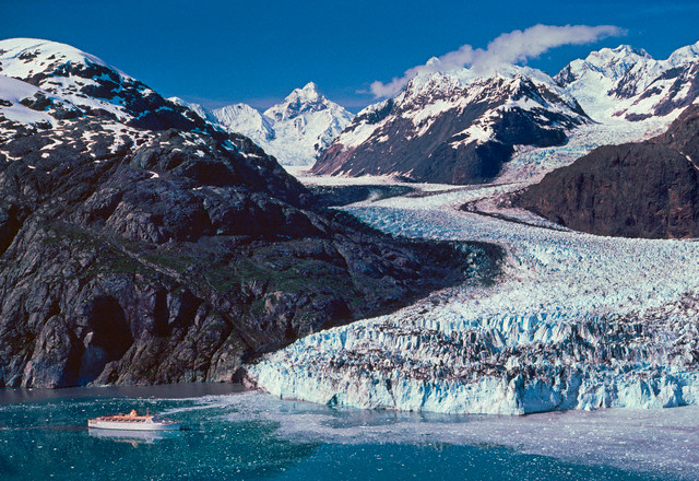 11. Glacier Bay National Monument, established  February 26, 1925. Margerie Glacier sprawls before a cruise ship visiting the site. Courtesy of Danny Lehman/Corbis.