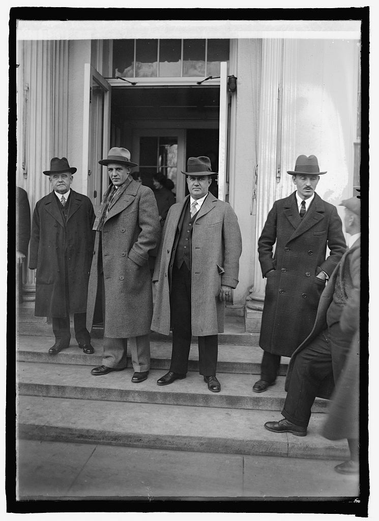 """Red"" Grange just after meeting the President, accompanied by Senator McKinley and Representative Holaday, December 8, 1925."
