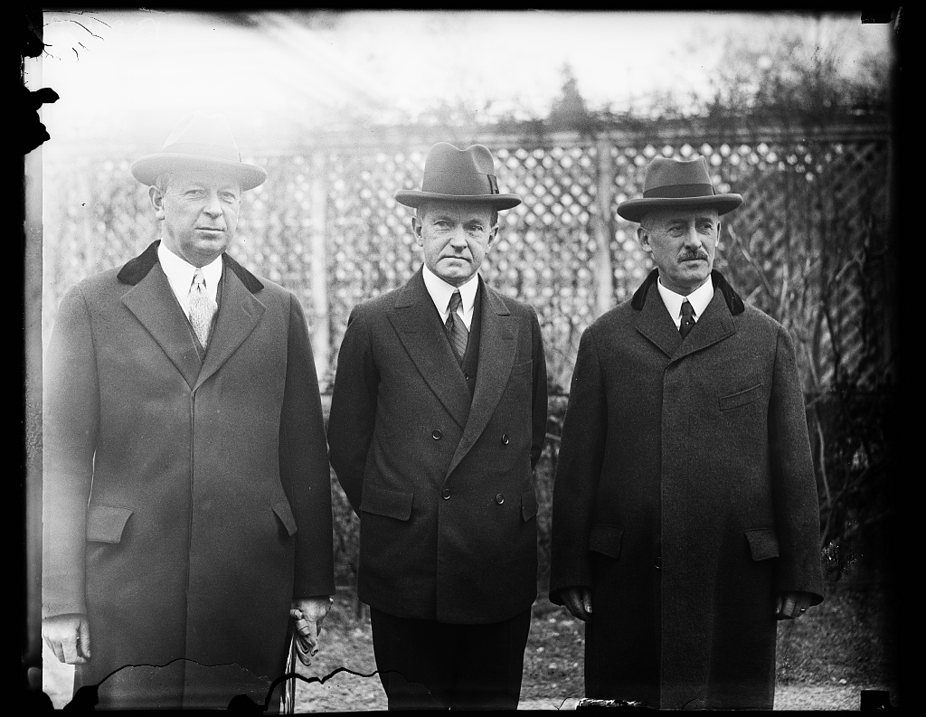 President Coolidge on the White House grounds with his Secretary of War, Dwight F. Davis, and his representative to Nicaragua and then the Philippines, Henry L. Stimson, circa early 1928.
