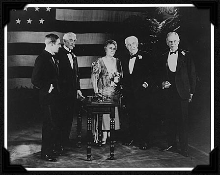 Secretary Mellon presenting Edison the Congressional Gold Medal, accompanying recognition by President Coolidge over radio hookup from the White House. L to R: Ronald Campbell (British Embassy, present to return the original phonograph lent by Edison to the British Science Museum 45 years earlier), Mellon, Mina and Thomas Edison, with John Hibben, President of Princeton University. Courtesy of the Smithsonian Institution.