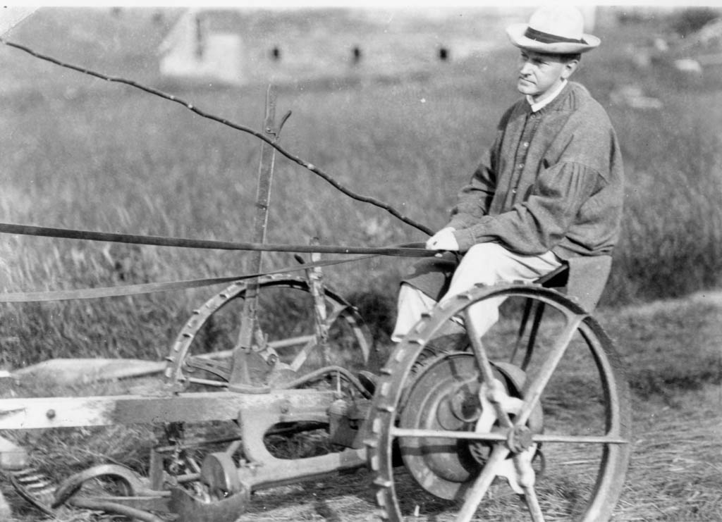 Coolidge, in his grandfather's frock, working the fields of the family Homestead.
