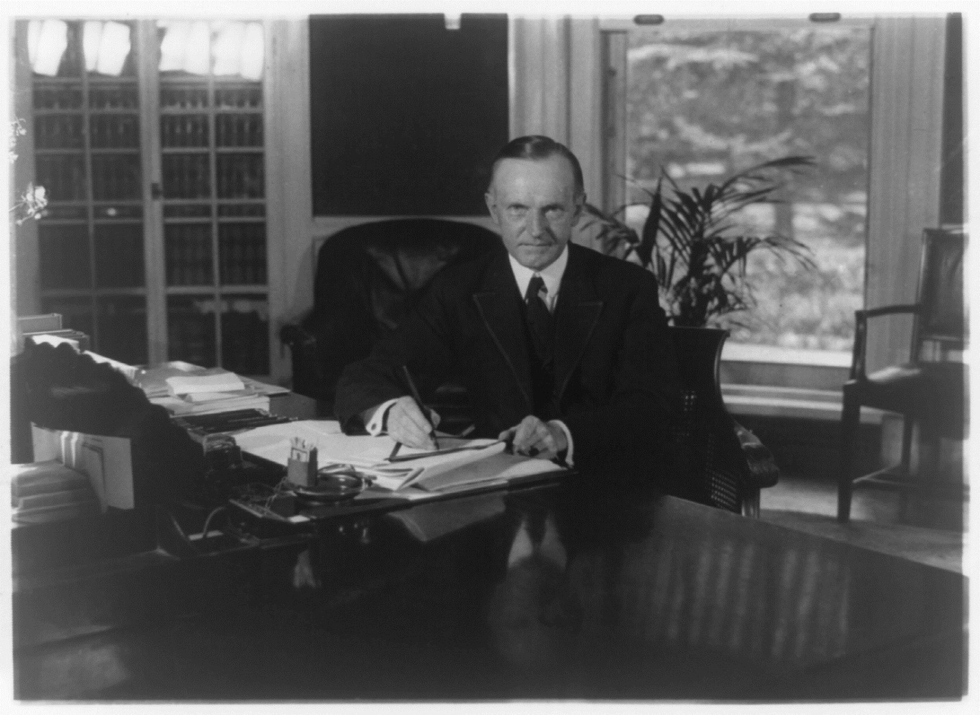 The President working at his desk, August 1923.